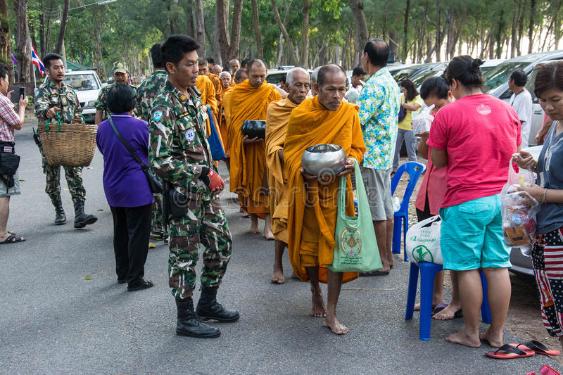 Buddhist monks are given food offering from people for Songkran day or Thai New Year Fe. Prachuap Khiri Khan, THAILAND - APRIL 13 : Buddhist monks are given food royalty free stock photos