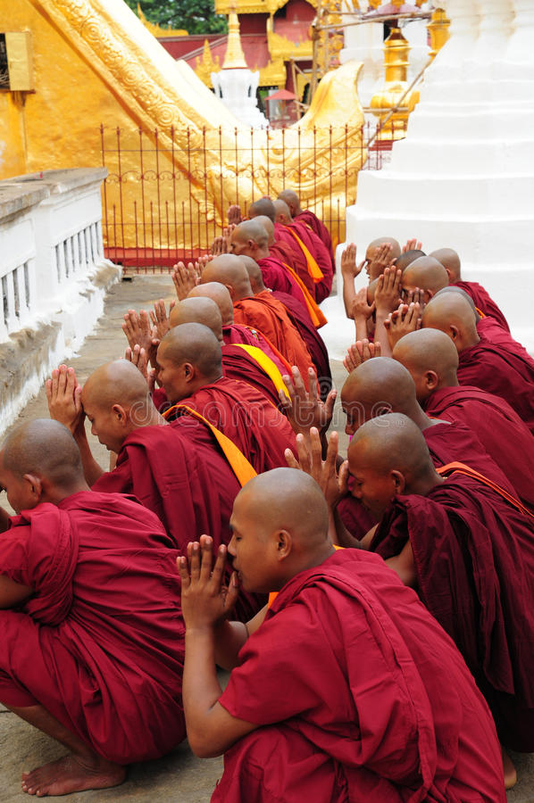 Buddhist monks Myanmar. Buddhist monks chanting at Shwezigon Temple in Bagan, Myanmar, Burma royalty free stock photos