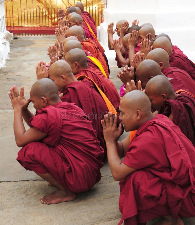 Buddhist monks Myanmar. Buddhist monks chanting at Shwezigon Temple in Bagan, Myanmar, Burma stock images