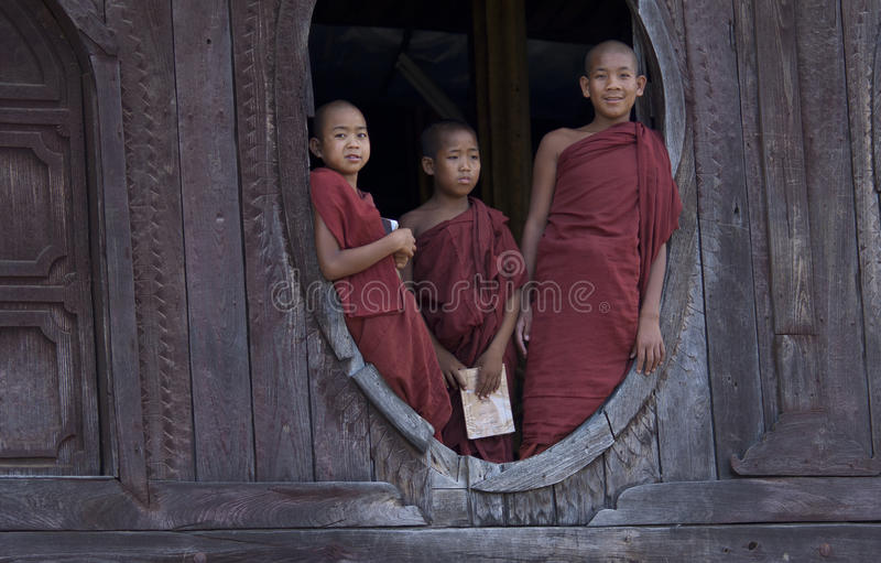 Buddhist Monks in Myanmar (Burma). Monks in Nyaung Shwe Monastery. It is an 18th century old teak wooden monastery which features a vulnerable consecrated hall stock images