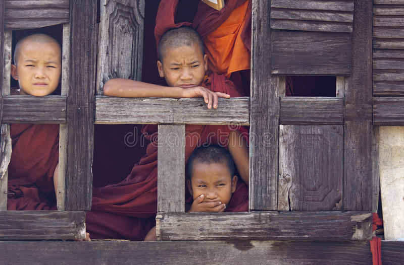 Buddhist Monks in Myanmar (Burma). Monks in Nyaung Shwe Monastery. It is an 18th century old teak wooden monastery which features a vulnerable consecrated hall royalty free stock photo