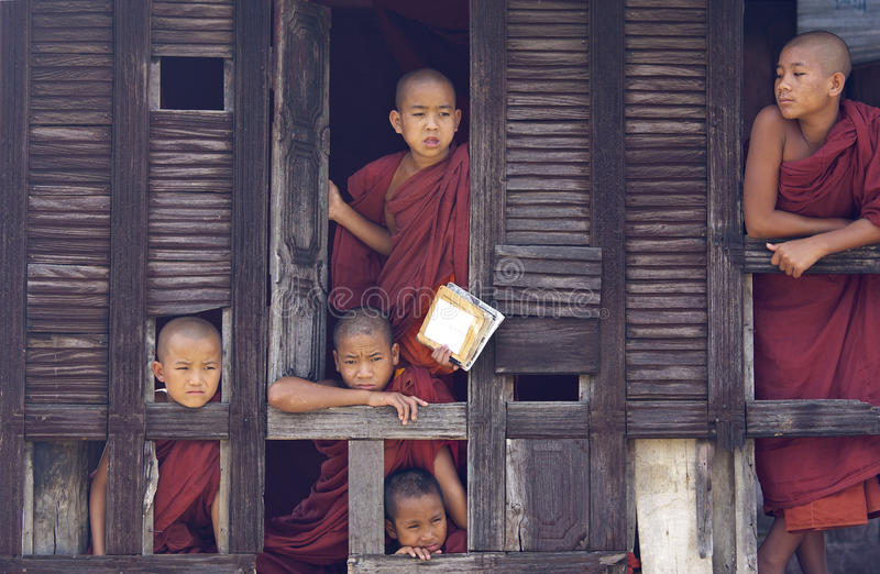 Buddhist Monks in Myanmar (Burma). Monks in Nyaung Shwe Monastery. It is an 18th century old teak wooden monastery which features a vulnerable consecrated hall stock photos