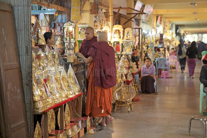 Buddhist monks Myanmar. Buddhist monks are buying the Mahamuni Buddha image at the shop in the gallery of the at the Mahamuni Buddha Temple, Mandalay, Myanmar stock photos