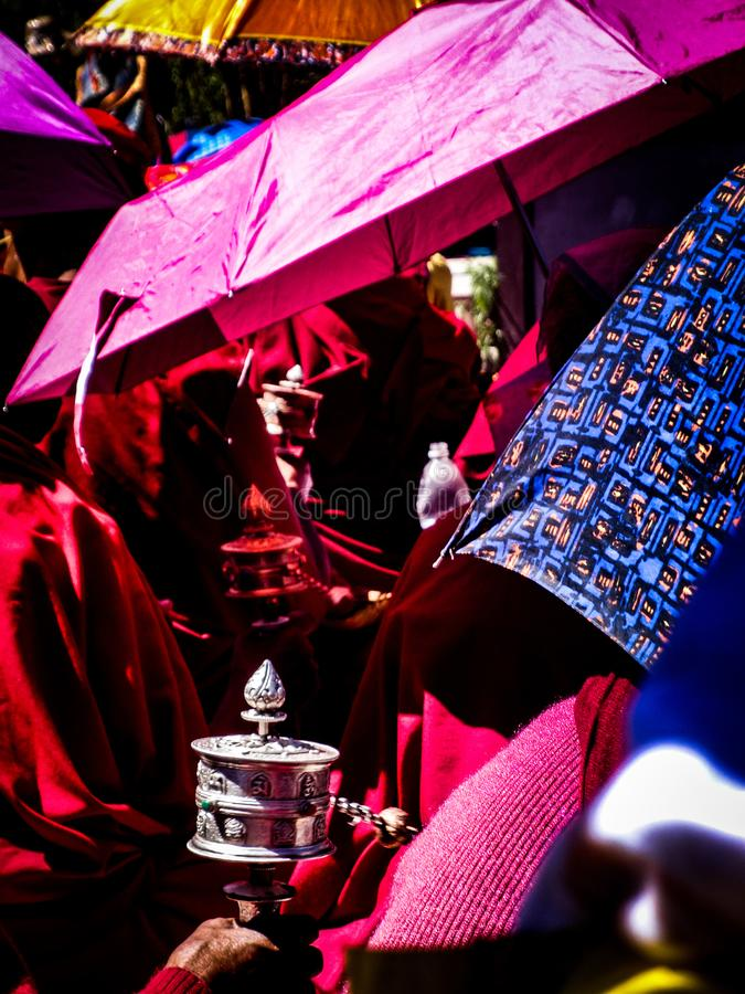 Buddhist monks with prayer drums stock images