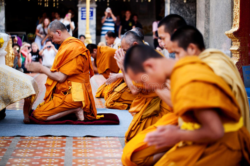 Buddhist monks praying on eve royalty free stock image