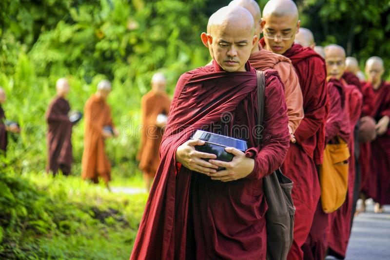 Buddhist monks in procession royalty free stock photography