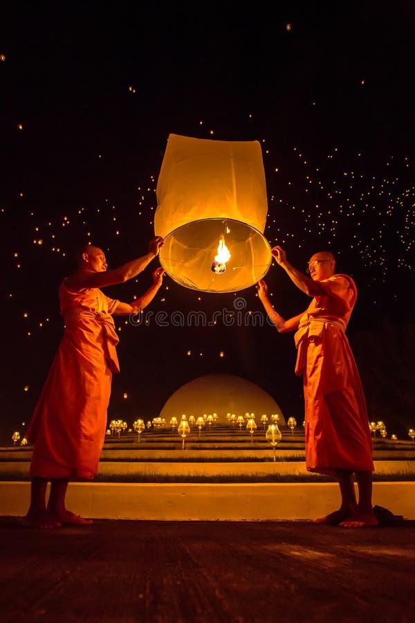 Buddhist monks release sky lantern to worship Buddha's relics stock image