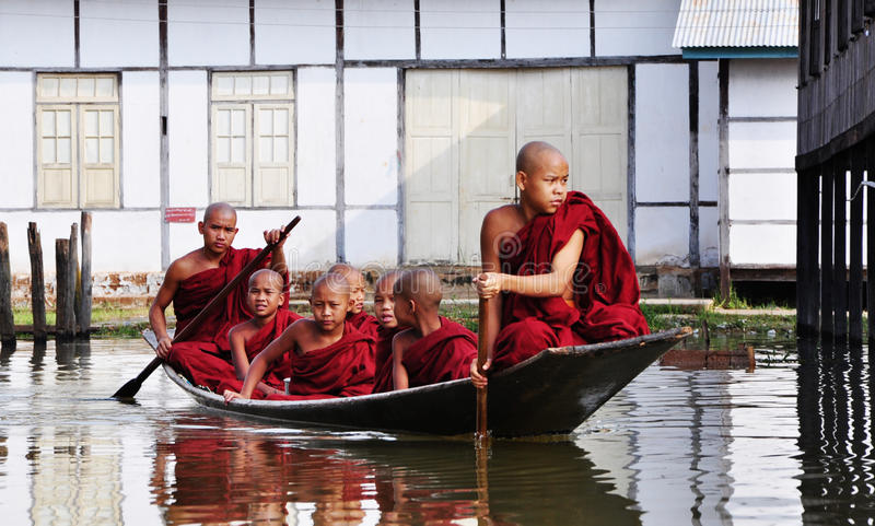 Buddhist monks rowing boats on the lake in Shan, Myanmar.  royalty free stock photo