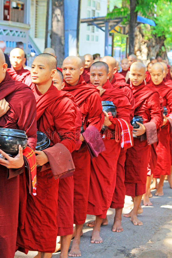 Buddhist Monks To Receive Donations Of Food, Mahagandayon Monastery, Mandalay, Myanmar. Buddhist Monks To Receive Donations Of Food in Myanmar royalty free stock image