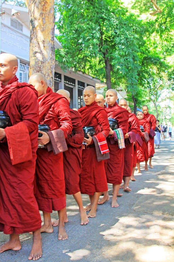 Buddhist Monks To Receive Donations Of Food, Mahagandayon Monastery, Mandalay, Myanmar. Buddhist Monks To Receive Donations Of Food in Myanmar stock photo