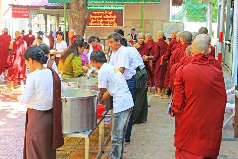 Buddhist Monks To Receive Donations Of Food, Mahagandayon Monastery, Mandalay, Myanmar. Buddhist Monks To Receive Donations Of Food in Myanmar royalty free stock photos
