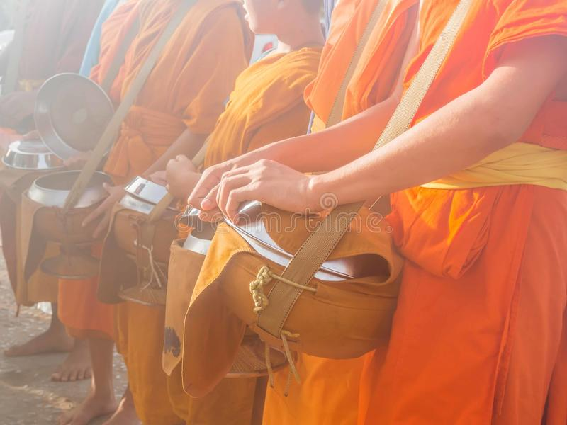 Buddhist monks waiting for food offering in the morning stock photography