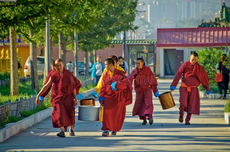 Buddhist monks walking in Mongolia royalty free stock photography