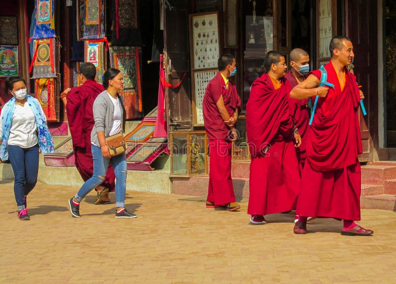 Buddhist monks on the street in Kathmandu, Nepal royalty free stock photos