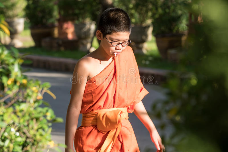 Buddhist Monks at Wat Prasing, Chiang Mai, Thailand. CHIN STATE, THAILAND - OCTOBER 15 2016: Young buddhist monks mourn the death of their King - Bhumibol royalty free stock photo
