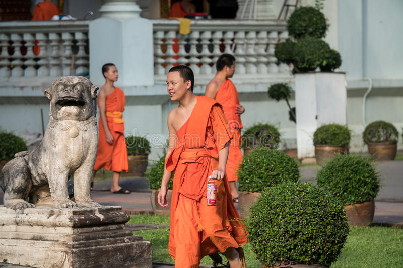 Buddhist Monks at Wat Prasing, Chiang Mai, Thailand. CHIN STATE, THAILAND - OCTOBER 15 2016: Young buddhist monks mourn the death of their King - Bhumibol stock photos