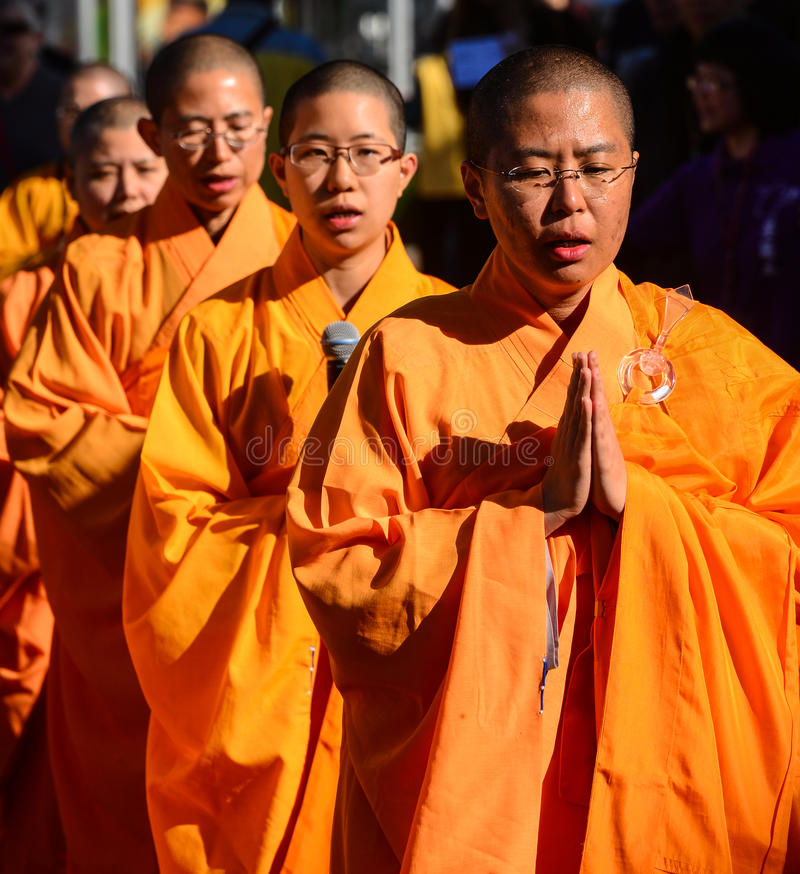 Buddhist monks. Wearing robes in a ceremony