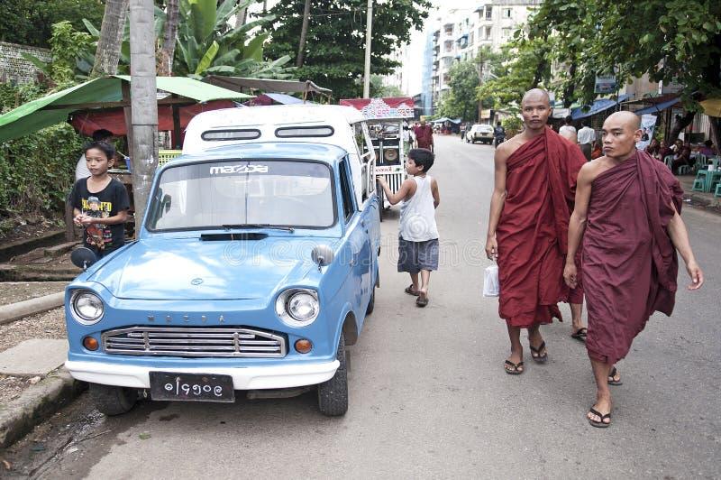 Buddhist monks in yangon street myanmar. Burma stock photo