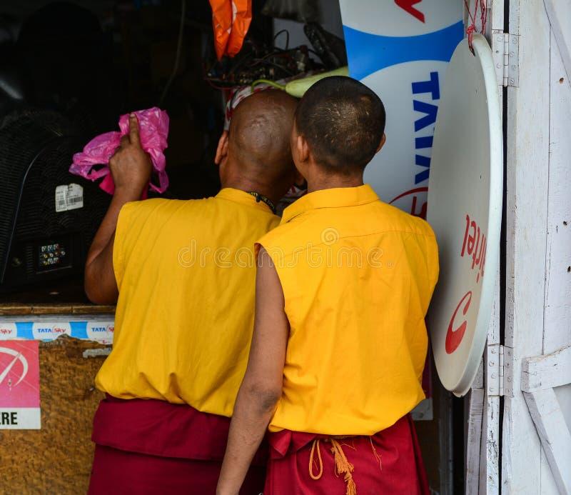 Buddhist novice monks on street. Bodhgaya, India - July 9, 2015. Buddhist novice monks on street in Bodhgaya, India. Bodhgaya is the most revered of all Buddhist stock photos