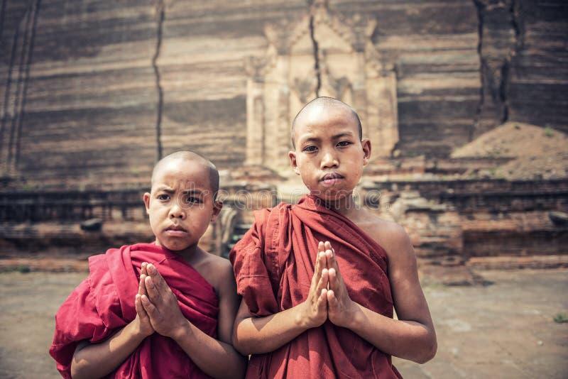 Buddhist novice pray at Mingun Pahtodawgyi. Mingun Paya, Myanmar stock photo