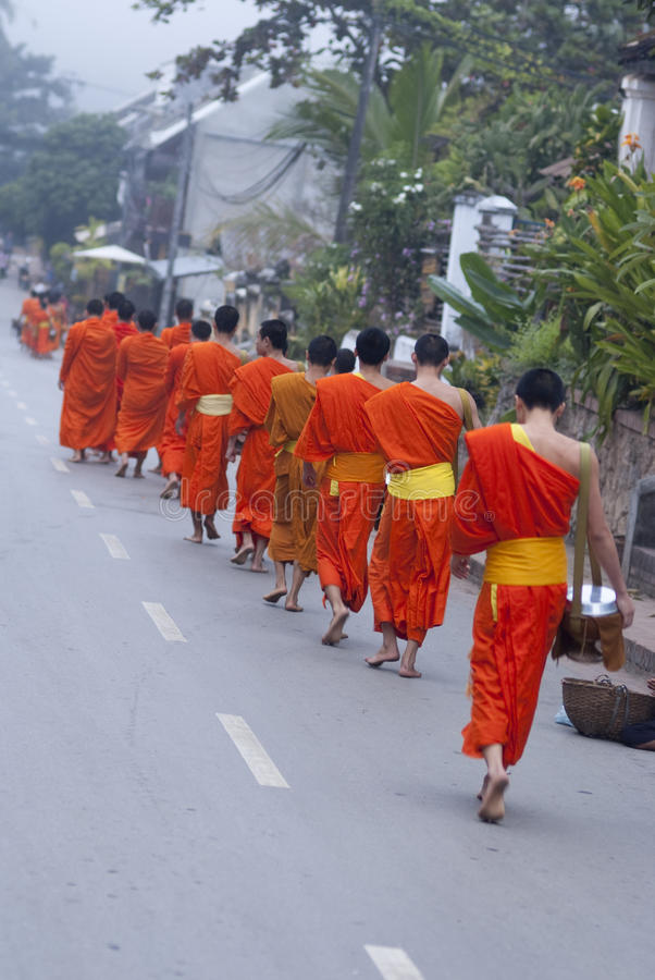 Download Buddhist Novices Walk To Collect Alms And Offerings, Luang Prabang, Laos. Editorial Photo - Image: 28913466