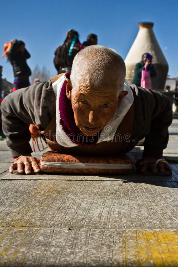 A Buddhist nun and her prosotrations, Jokhang Temple. Lhasa Tibet royalty free stock images