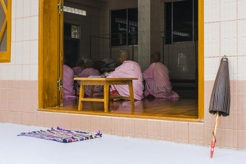 Buddhist nuns in Myanmar. Buddhist nuns learn inside the monastery in Mandalay, Myanmar, Burma stock image