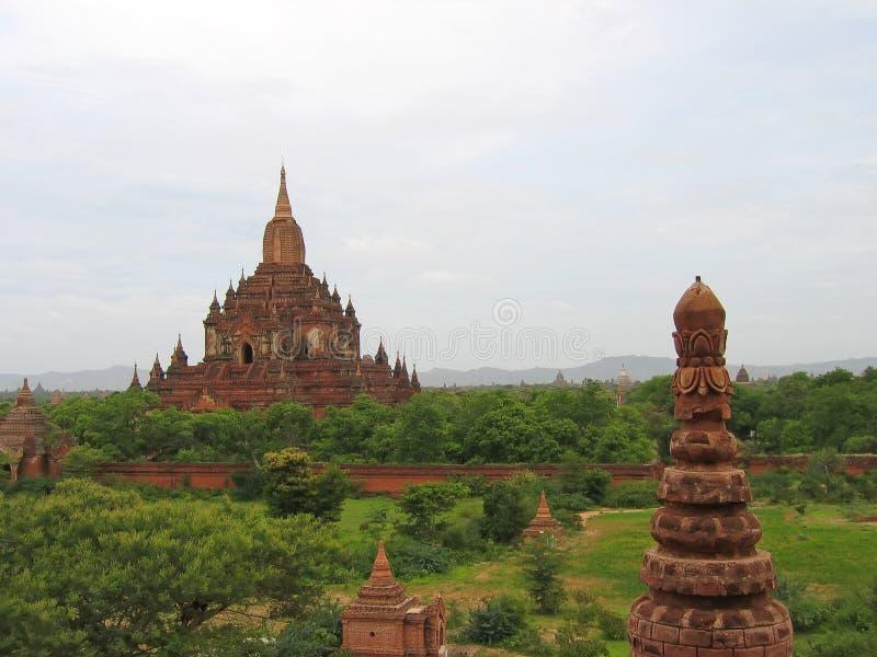 Buddhist paya in red rocks, Bagan, Myanmar royalty free stock photos