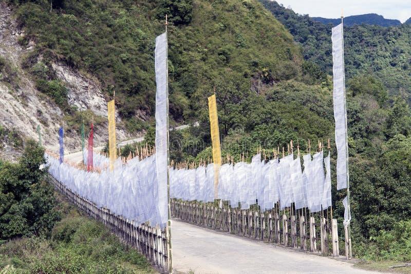 Buddhist Prayer Flags - Bhutan. Buddhist Prayer Flags on a road bridge near Trashigang - Eastern Bhutan stock photo