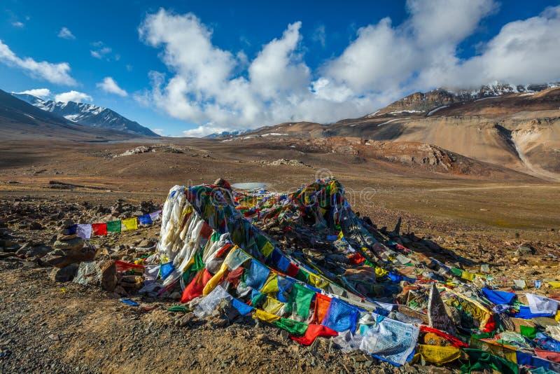 Buddhist prayer flags (lungta) on Baralacha La pass in Himalayas stock image