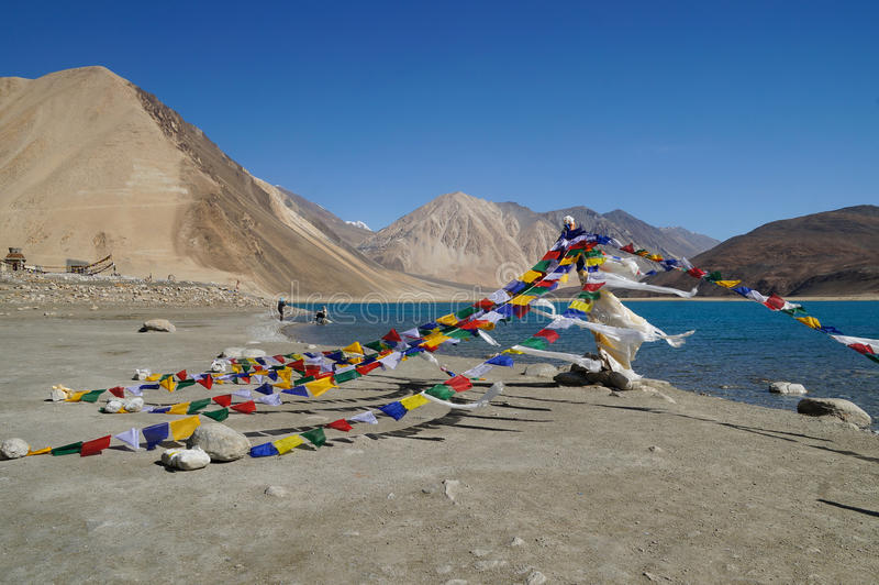 Buddhist prayer flags at Pangong Lake in Ladakh, India stock photos