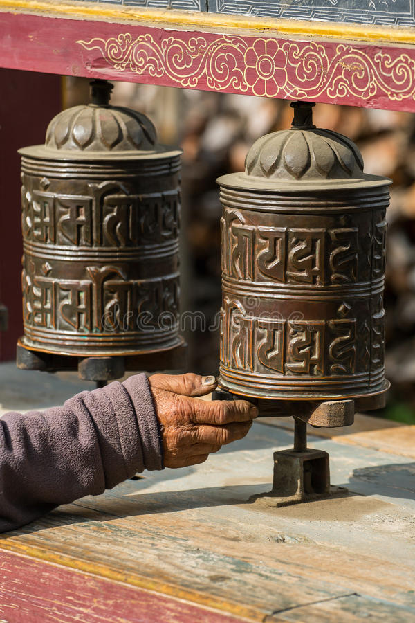 Buddhist prayer mani wall with prayer wheels in nepalese village. On the Annapurna circuit trekking route, Nepal stock images
