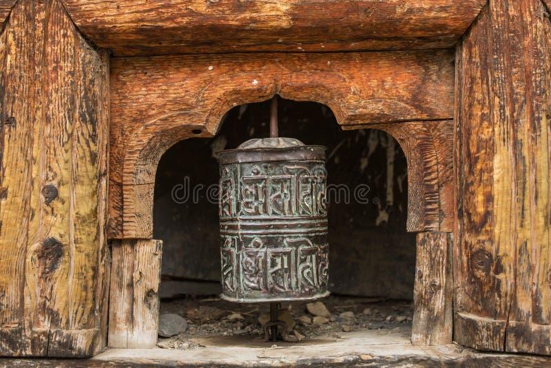 Buddhist prayer mani wall with prayer wheels in nepalese village. On the Annapurna circuit trekking route, Nepal stock photos