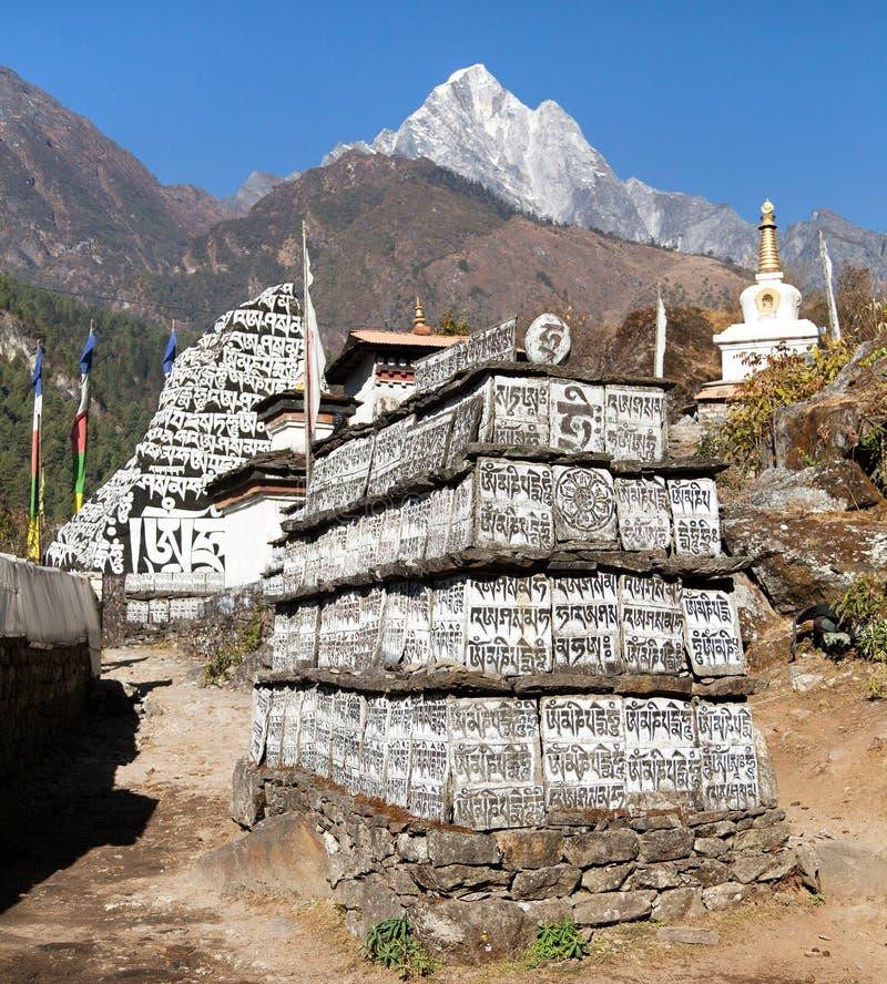 Buddhist prayer mani walls. Way to Everest base camp, way from Lukla to Namche Bazar, Nepal royalty free stock image