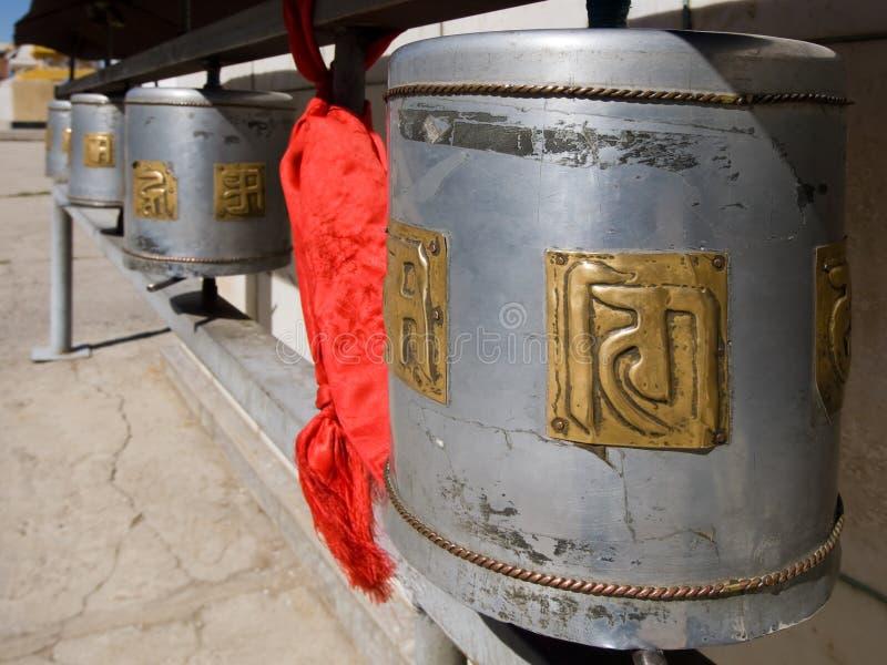 Buddhist prayer wheels. Row of buddhist prayer wheels in Gandan Monastery, Mongolia royalty free stock photo
