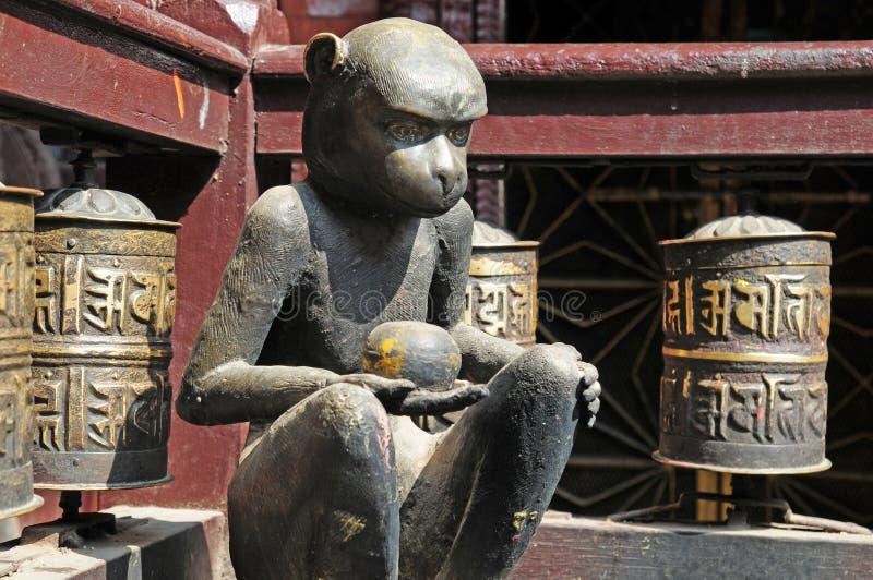 Buddhist prayer wheels an monkey at Golden Temple royalty free stock image