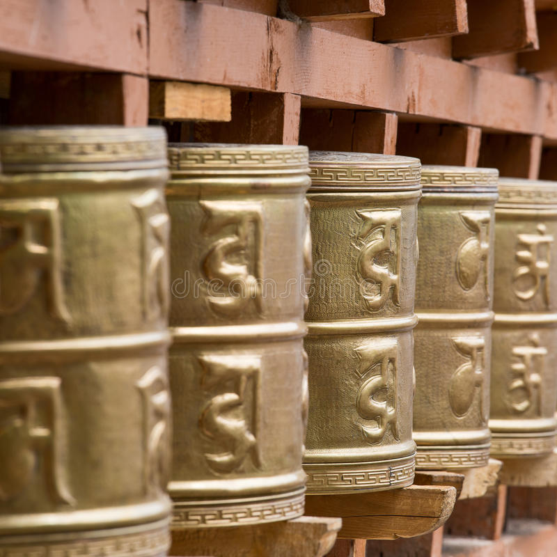 Buddhist prayer wheels in Tibetan monastery . India, Himalaya, Ladakh stock images