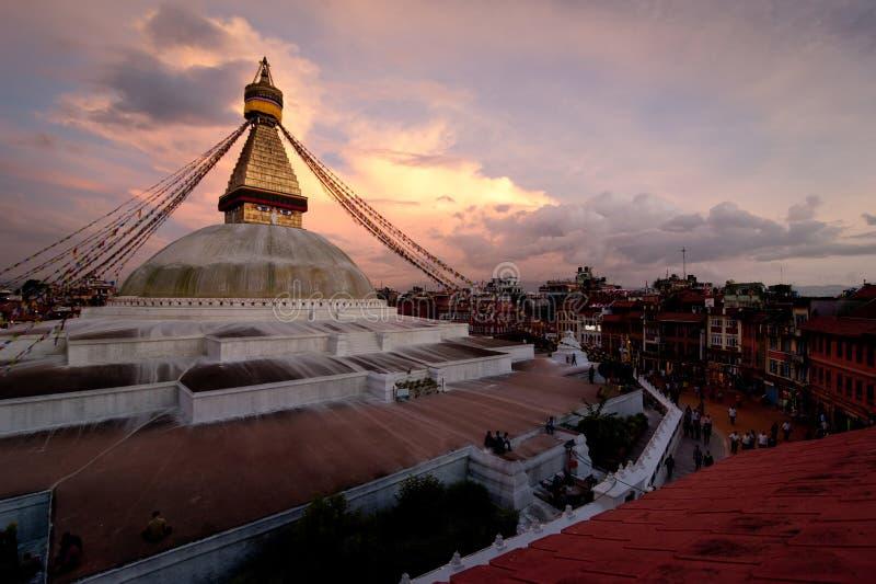 Buddhist Shrine Boudhanath Stupa. Nepal, Kathmandu. Buddhist Shrine Boudhanath Stupa with pray flags over sunset sky. Nepal, Kathmandu stock photos