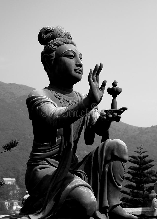 Buddhist statue in black and white stock photo