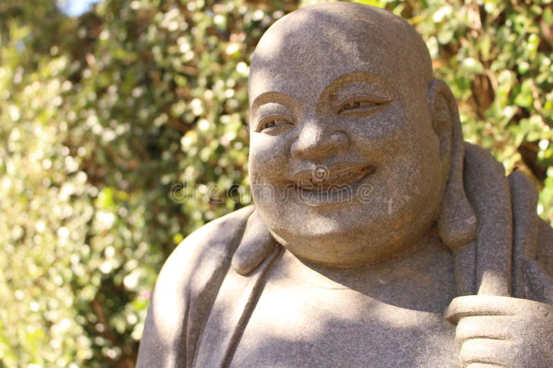 Buddhist statue. In a florest royalty free stock image