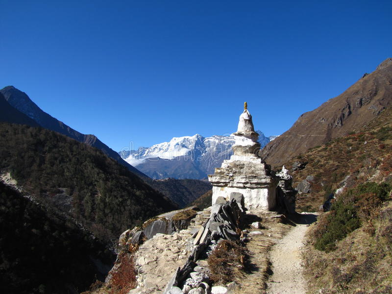 Buddhist stupa in the background of mountains in the Himalayas. The spirit of inspiration royalty free stock photography