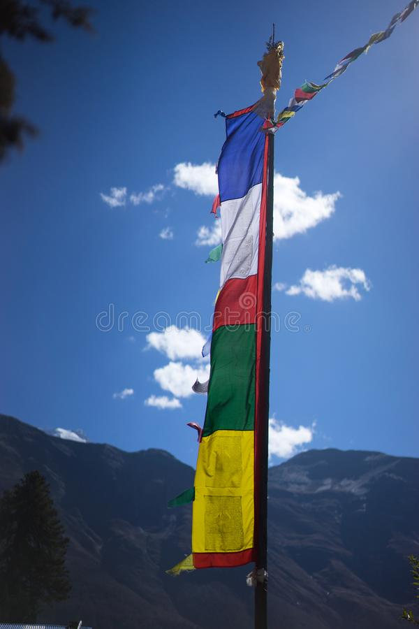 Buddhist gompa and prayer flags in the Himalaya mountains, Annapurna region, Nepal royalty free stock photo
