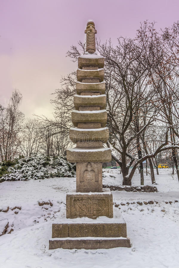 Buddhist stupa in stylized Japanese park in Kiev in winter royalty free stock photo