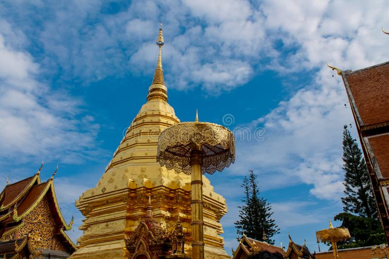 Buddhist temple golden pagoda of Doi Suthep in Thailand. Beautiful buddhist temple pagoda monastery in Thailand. Buddhist temple golden pagoda of Doi Suthep in stock images