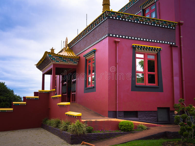 Buddhist temple. In Gramado - Tres Coracoes - Brazil, the red and gold contrasts with the grey clouds in the sky stock image