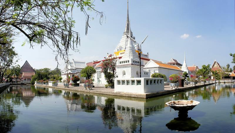 Buddhist temple with moat around, Bangkok. Thai Buddhist temple Wat Khan Lad is surrounded by a pond of water in Bangkok, Thailand stock photo