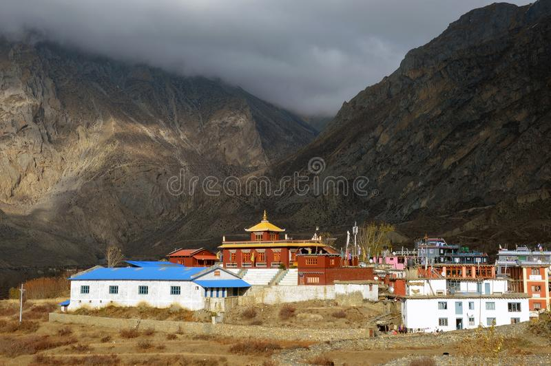 A Buddhist temple at Muktinath, Nepal on the Annapurna Circuit. Below Thorong La pass, With the Himalayas behind.  stock image