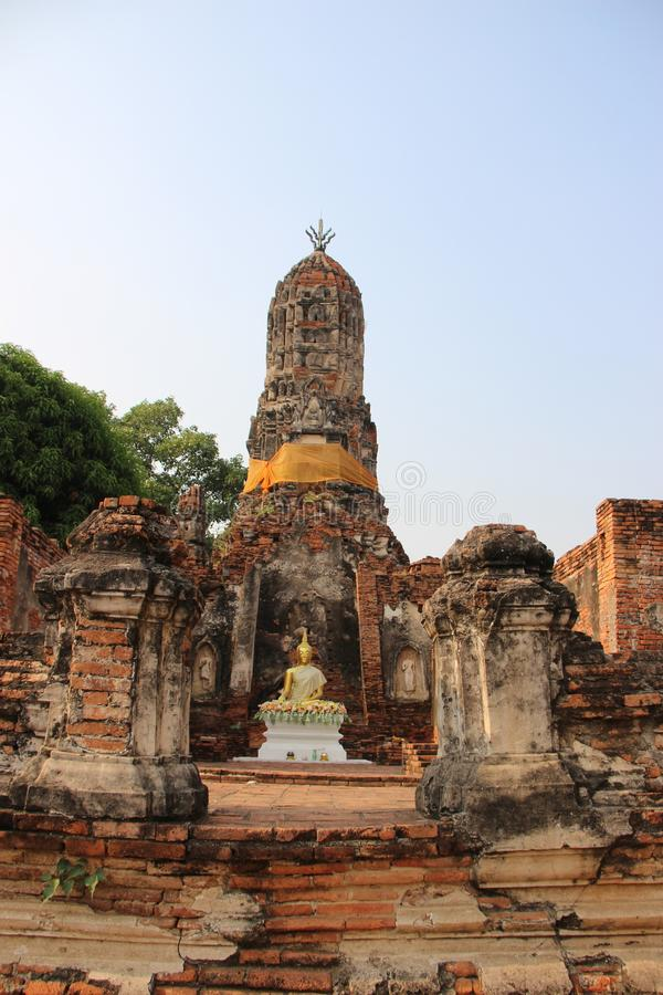 Buddhist Temple  And Old Stupa With Bricks Walls. Ruins. Choeng Tha temple with old pagoda and bricks walls Buddhist historical park. summer in Ayutthaya royalty free stock images
