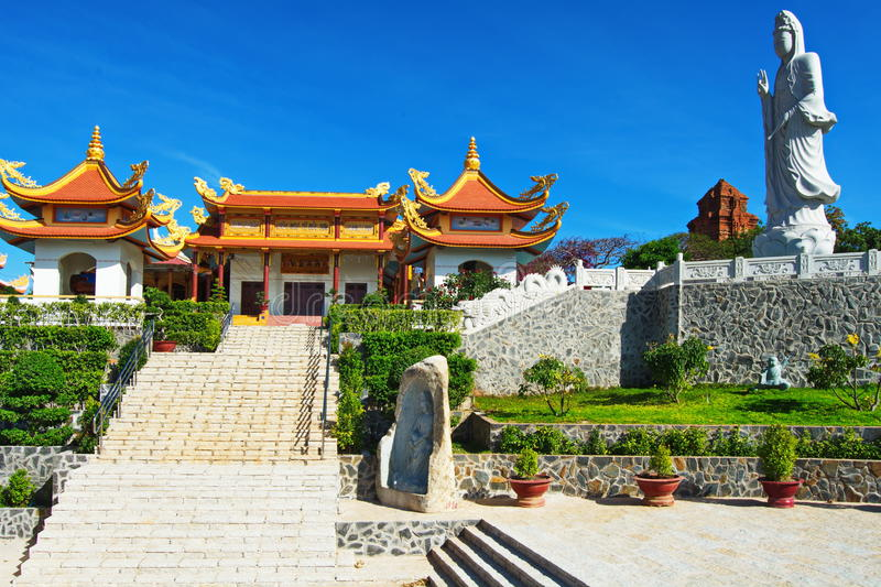 Buddhist temple in Phan Thiet, Southern Vietnam. Mui Ne, Viet Nam, Buddhist temple and statue in Phan Thiet stock photography