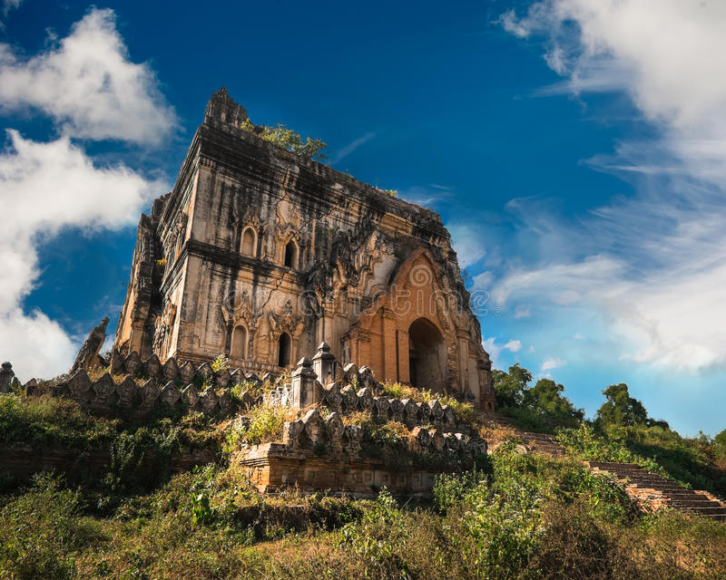 Buddhist Temple ruins in Inwa city. Myanmar (Burma). Cloudy sky over amazing architecture of old Buddhist Temple ruins at Inwa city near Mandalay. Myanmar (Burma royalty free stock photo